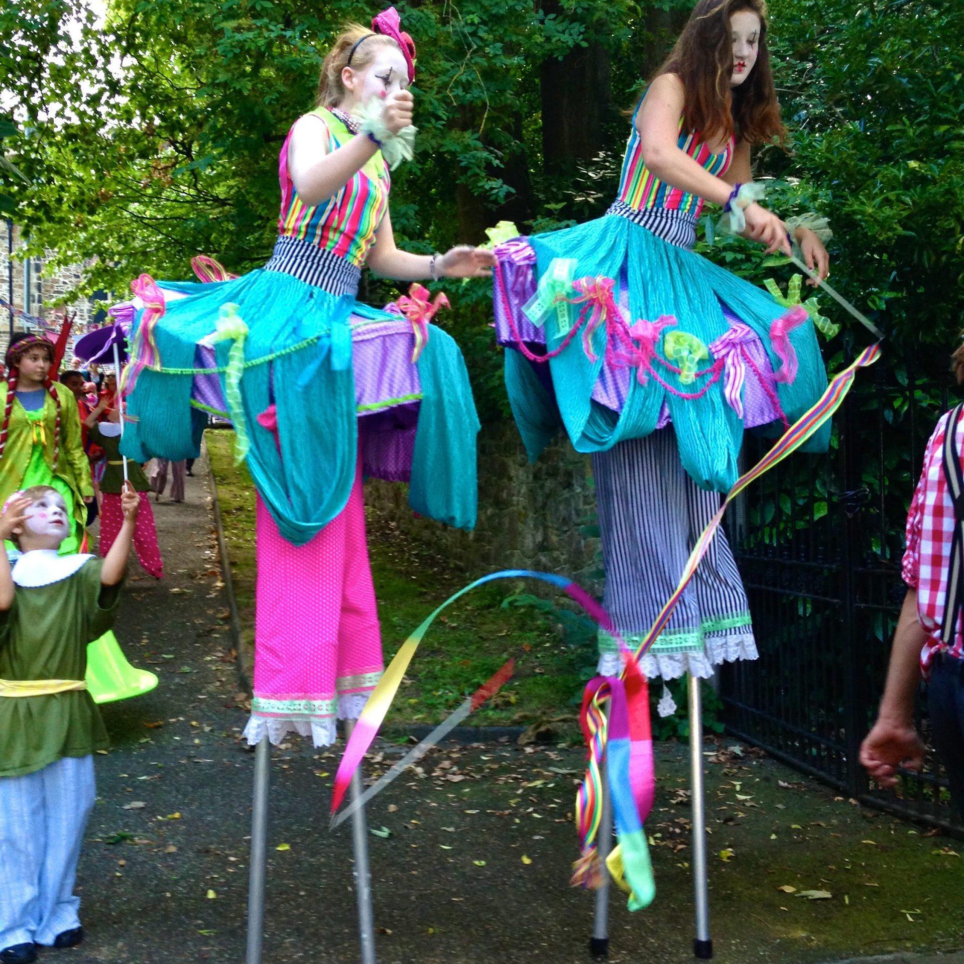 Two girls stilt walking